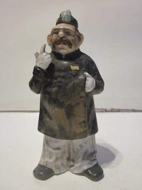 ANTIQUE PORCELAIN FIGURAL LIQUOR BOTTLE EUROPEAN POLICEMAN FIGURE