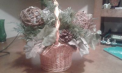 Decorative basket with artificial plant