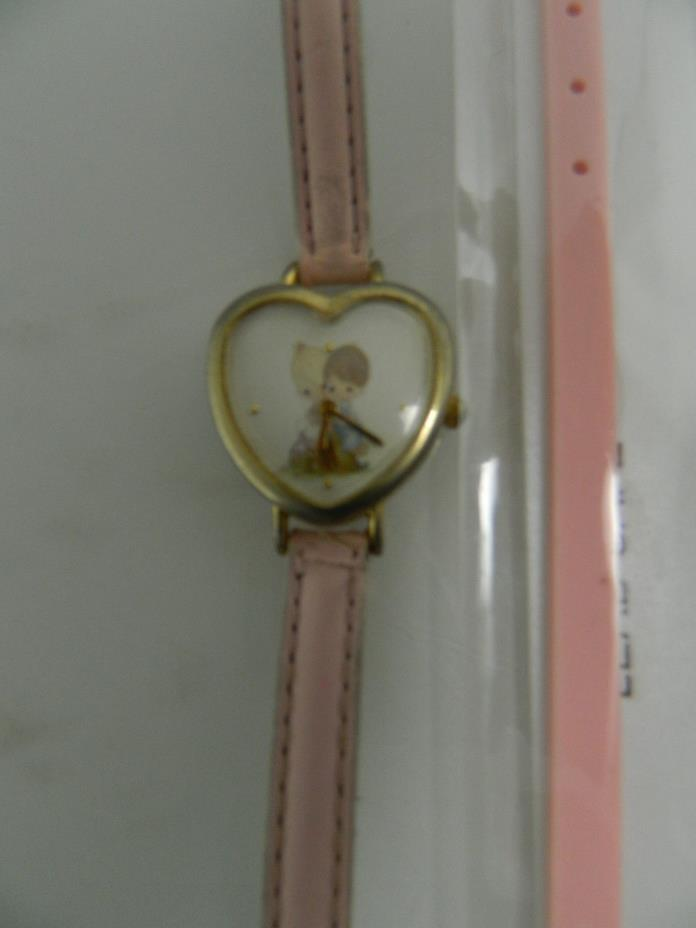 Precious Moments watch with 8 inch light pink leather band