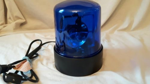 Blue rotating police beacon light