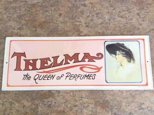 THELMA Vintage 1974 The Queen of Perfumes metal tin litho embossed sign 19 x 7in