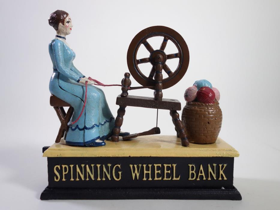 VINTAGE REPRODUCTION CAST IRON MECHANICAL SPINNING WHEEL BANK