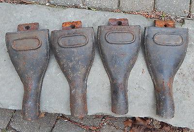 FOUR VINTAGE CAST IRON WOOD STOVE LEGS