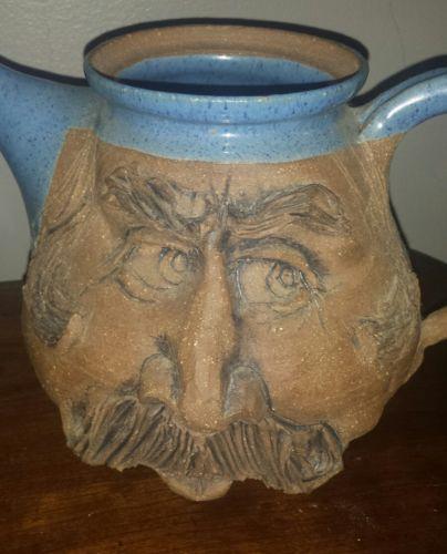 vintage stoneware teapot face