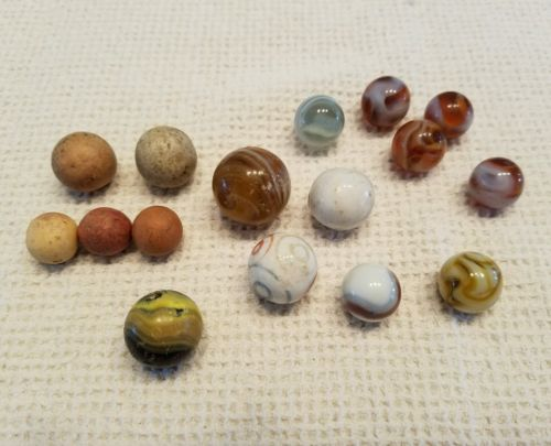 Antique Clay and Glass German Marbles. One shooter