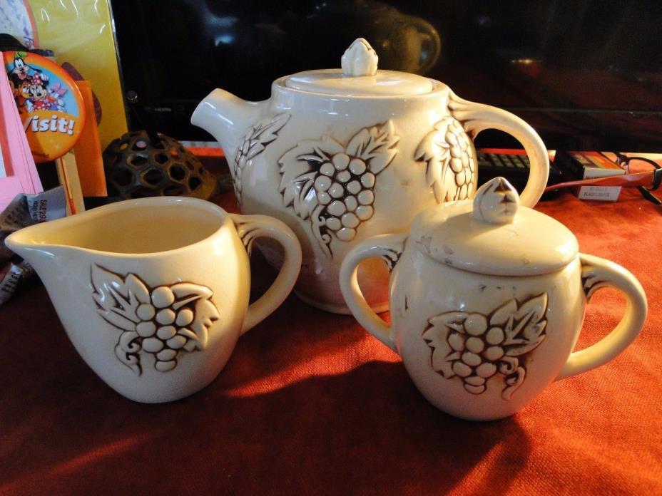 ITEM 403     Red Wing Tea Set - Teapot, Sugar, and Creamer
