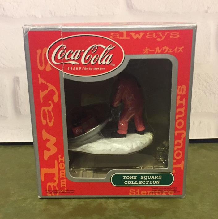 Coca Cola Town Square Collection Girl with Cat in Sled