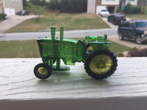 Plastic John Deere tractor. Scale 1:64.