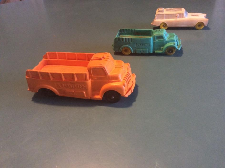 Vintage Auburn toy trucks and station wagon