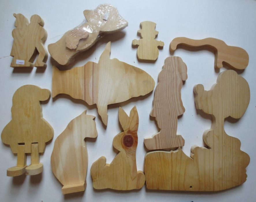 Lot 10  Assorted Unfinished Wooden Cutouts- Claus, Cat, Rabbit, Woman