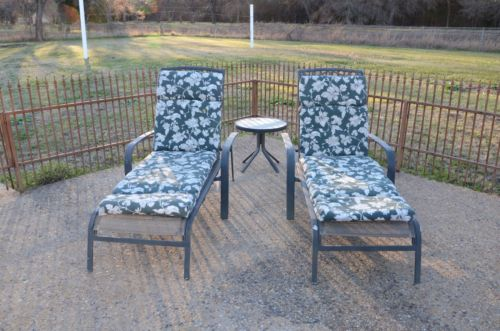 TWO OUTDOOR CHAISE LOUNGES WITH CUSHIONS FOR PRICE OF ONE INCLUDES TABLE
