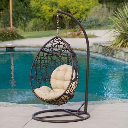 wicker teardrop swinging chair by Christopher