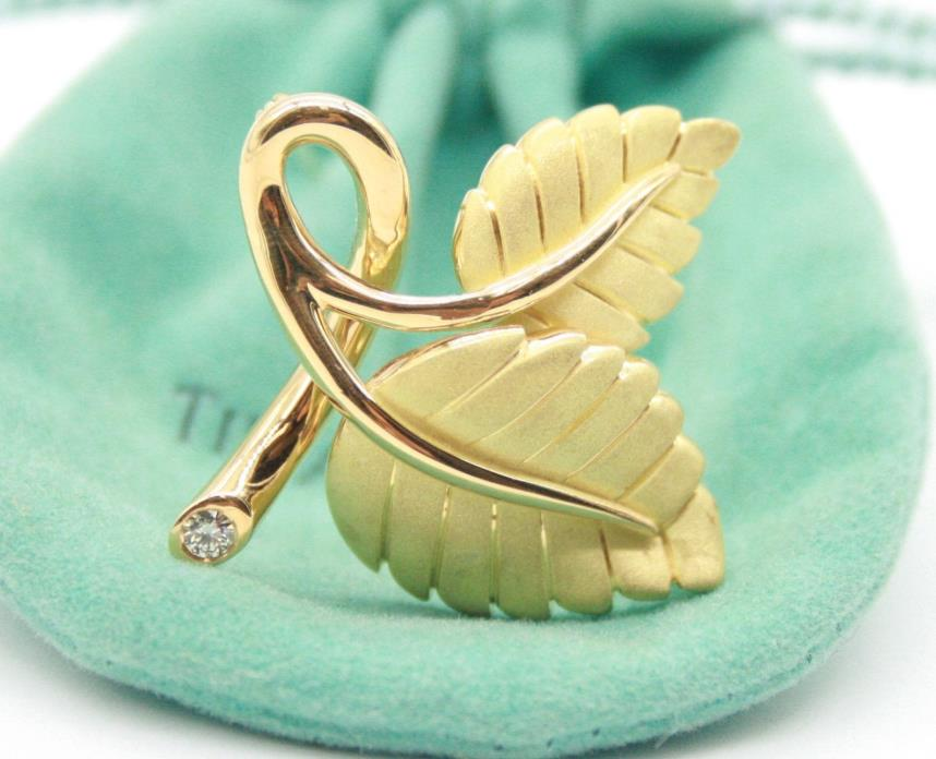 Tiffany & Co 18K Yellow Gold Strawberry Leaf Brooch with a Round Diamond.