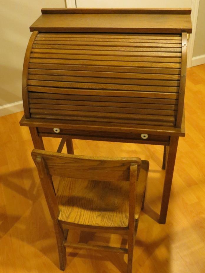 Antique child's roll top oak desk with oak chair