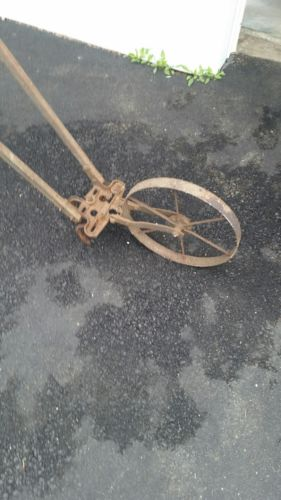 Vintage / Antique tiller/ Garden Cultivator, push type or lawn decoration