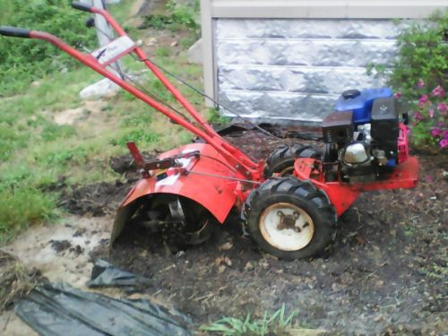 Ariens rocket 7 rear tine tiller new engine and tines. Works like a mule!
