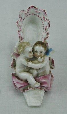 Early 1800's Sitzendorf figurine TWO CHERUBS IN A LADY'S SHOE.  (BI#MK/0417)