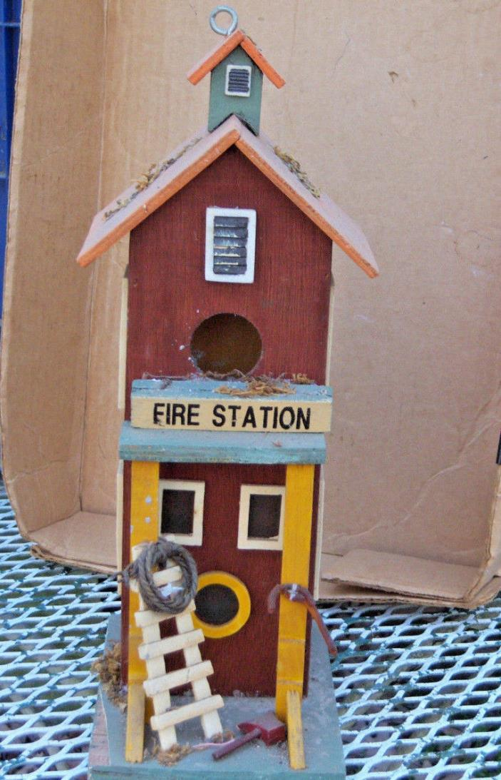 Wooden fire station birdhouse with a ladder, rope, cane, hammer and lifesaver de