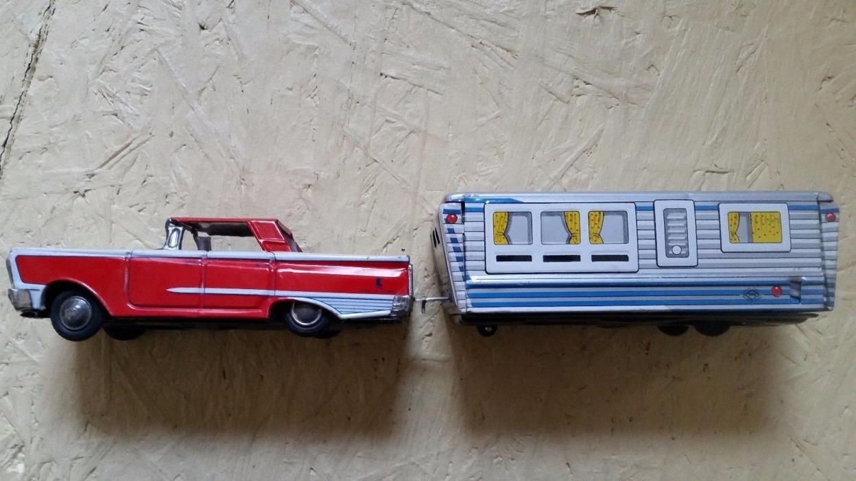 Vintage tin toy car and camper rv trailer