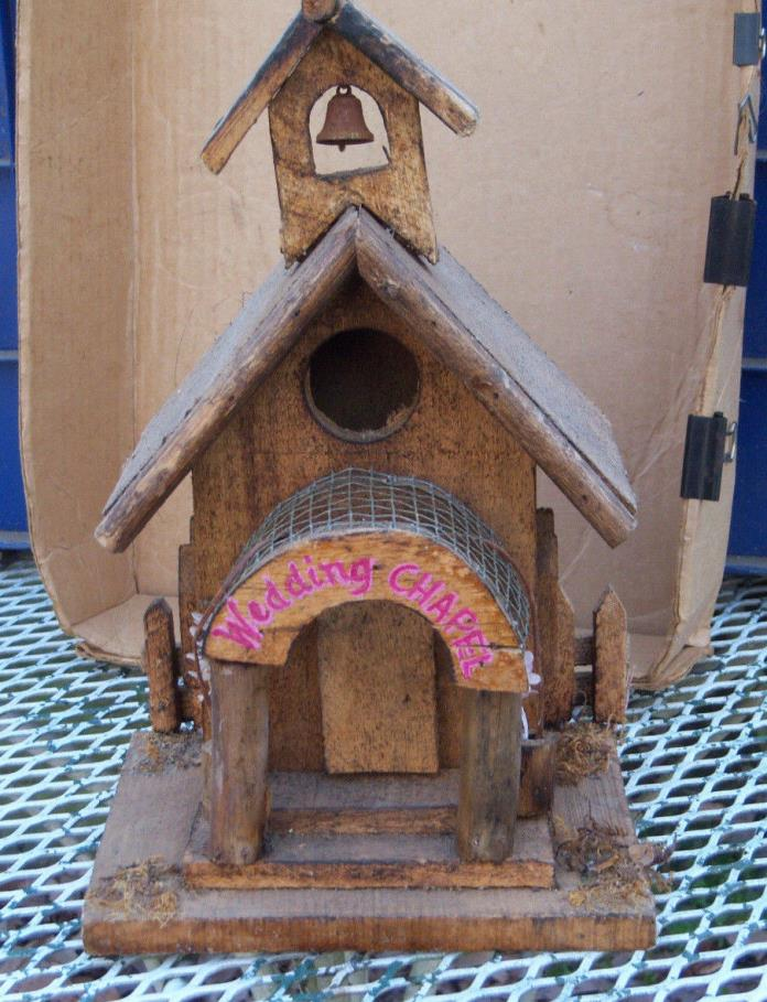 Wooden unpainted wedding chapel birdhouse with Wedding Chapel stamped on the fra