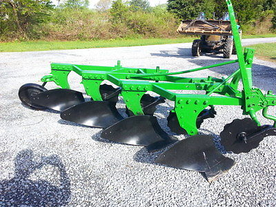 John Deere 4 BOTTOM PLOW W/COULTERS & TAIL WHEEL