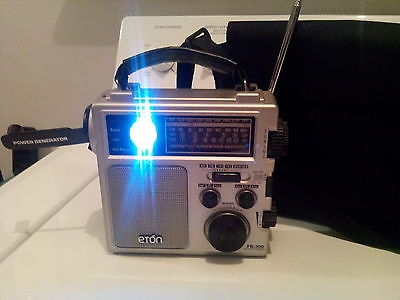 Eton self powered radio,light,cell phone charger,weather Chanel's,siren,flash,sw