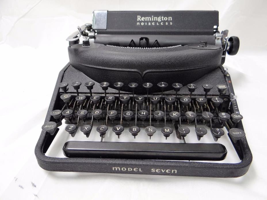 VINTAGE REMINGTON portable NOISELESS TYPEWRITER WITH CARRYING CASE WORKS!!