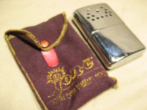 Vintage Jon-e Hand warmer in worn fabric bag
