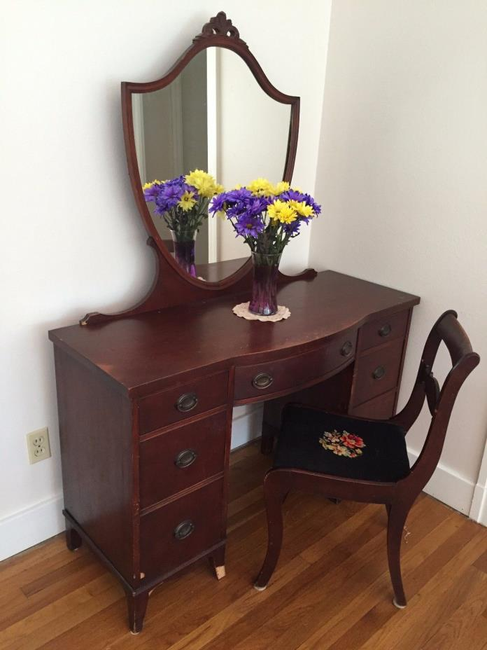 mahogany vanity with mirror, 1940s, with needlepoint chair. Good condition.