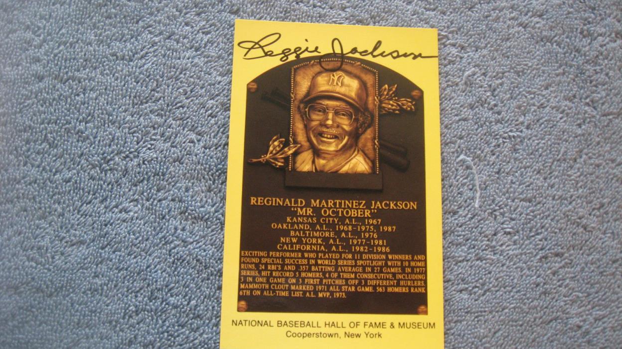 Autographed Reggie Jackson gold baseball HOF Plaque postcard.
