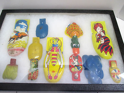 Vintage Collection of Various Colorful Tin Toys Clickers/Noise Makers in Case.