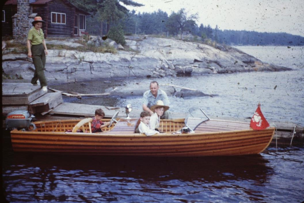 FAMILY READY FOR A RIDE IN THEIR WOODEN BOAT canoe lake  35MM SLIDE RED BORDER