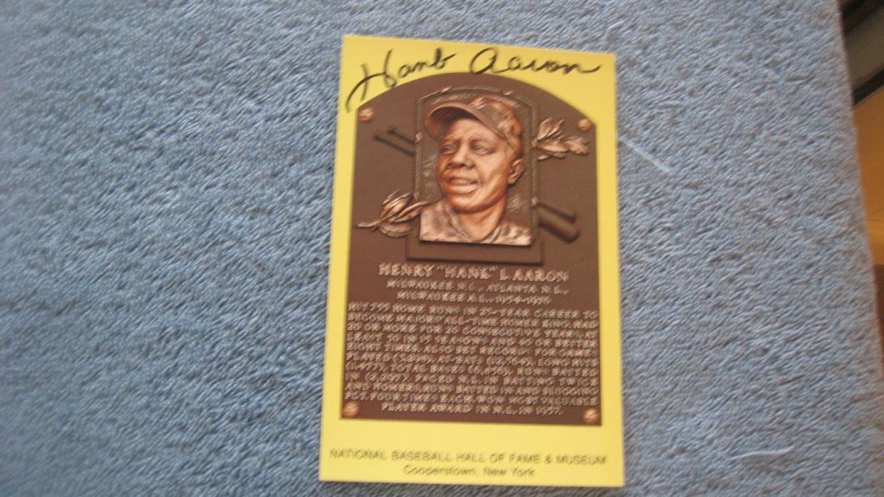 Autographed Hank Aaron gold baseball HOF Plaque postcard.