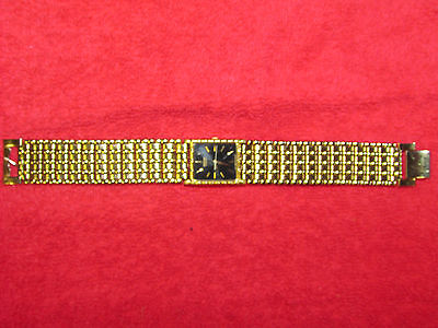gold plated 1980s metal band seiko watch womens men retro mod