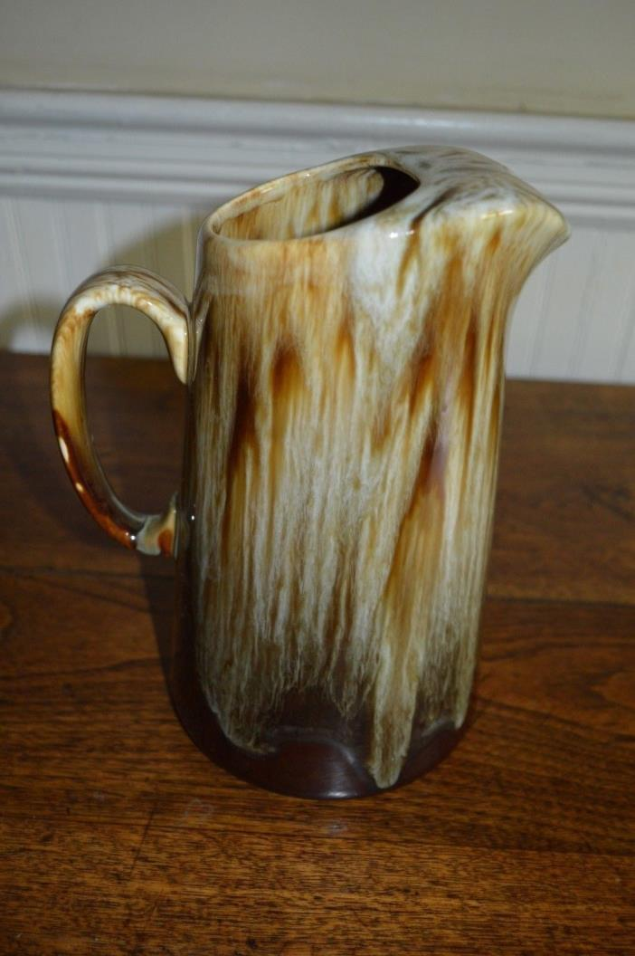 Brown drip water pitcher with ice lip