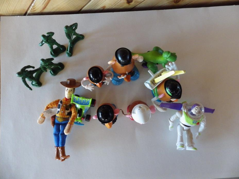 12  Disney Toy Story Toys .    Woody, Potato Heads, Soilders,Buzz, Race Car Rex
