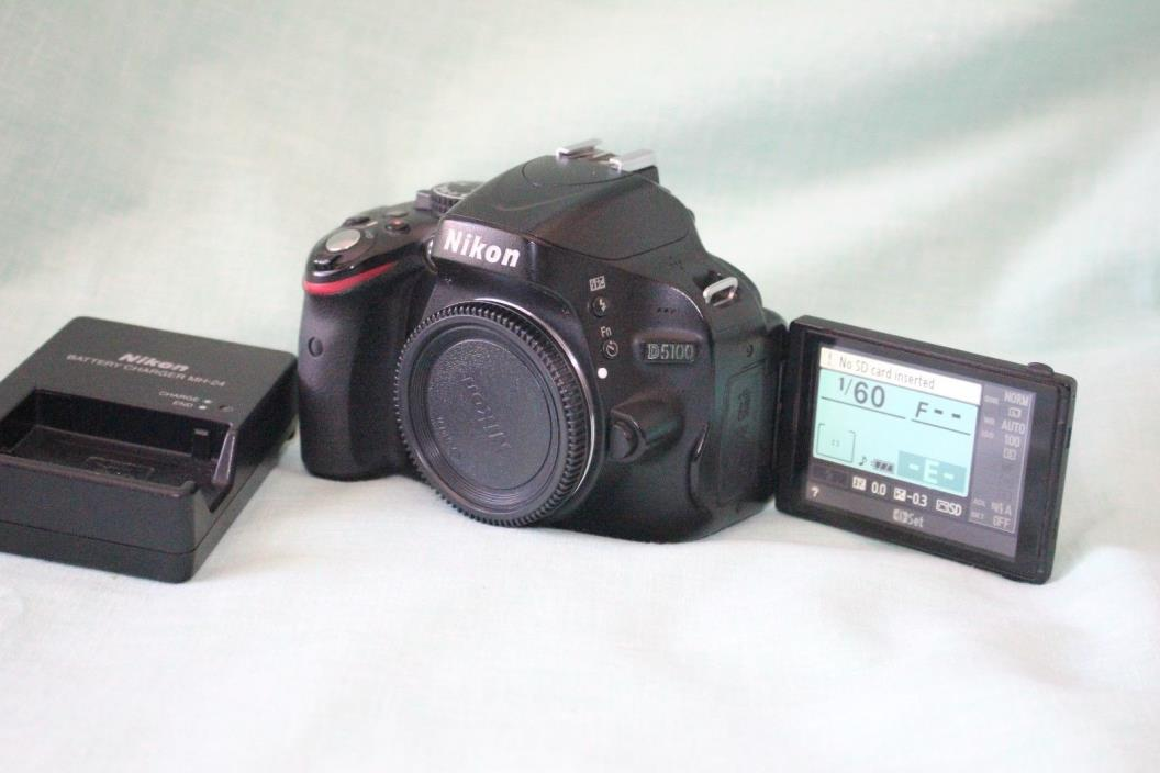 Nikon D5100 DSLR Camera body/charger/battery