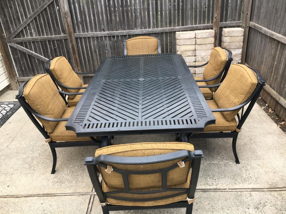 Black metal patio dining set with 7ft x 3.5ft table & 6 cushioned chairs