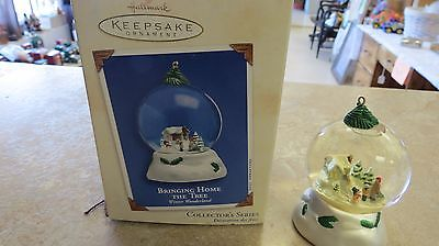 Hallmark ornament Bringing Home the Tree 2002