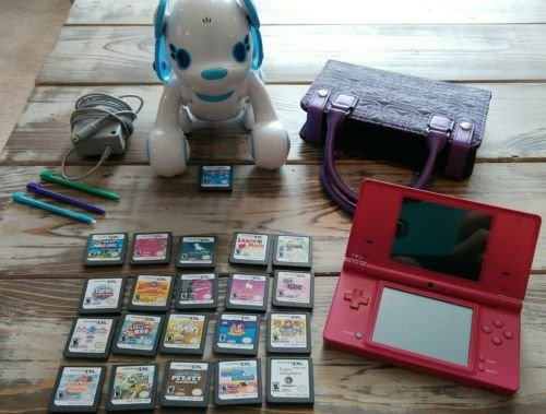 Nintendo DSI (pink), with 21 games (pictured), pens, case + 2 chargers?. Bundle!