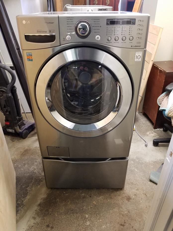 STAINLESS LG WASHER AND DRYER (GAS)+STANDS