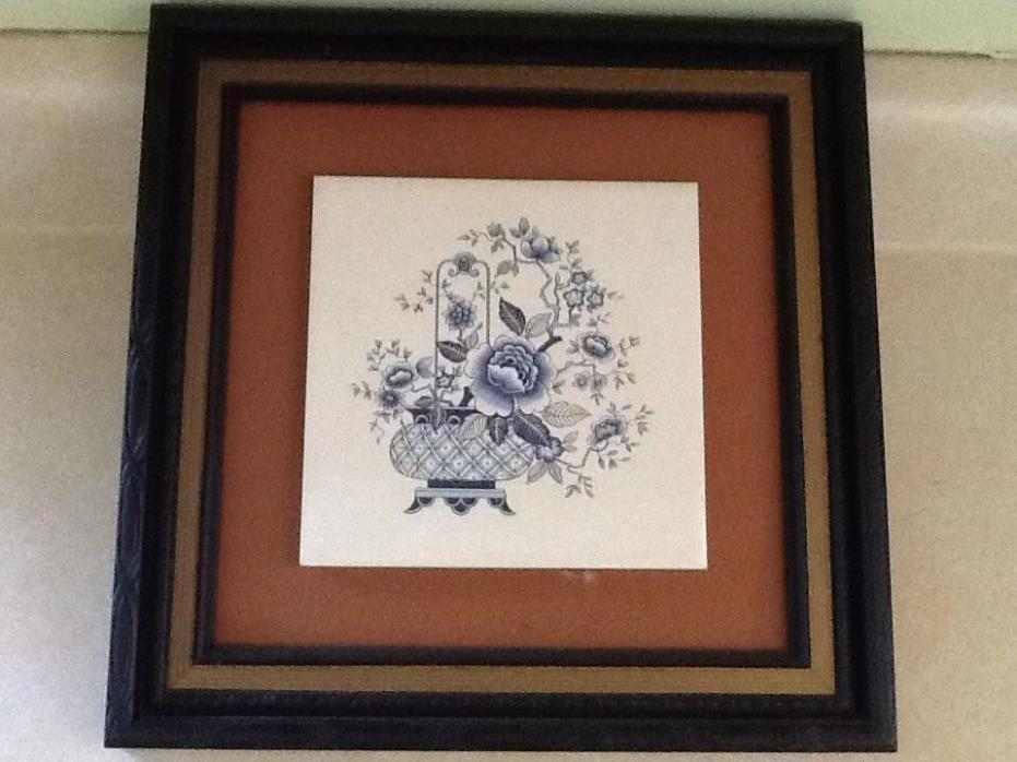 framed tile with flower pattern, blue (Victorian style?) pot with flowing flower