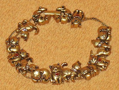VINTAGE CAT GOLD TONE BRACELET WITH HEARTS AND CRYSTALS