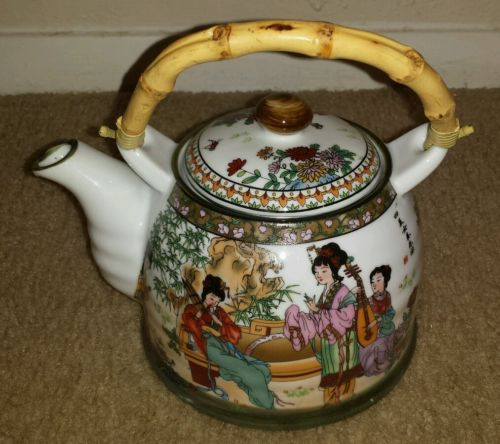 Asian teapot with bamboo handle Geishas