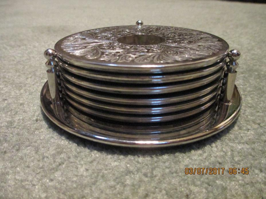 Silverplated 7 piece coaster set
