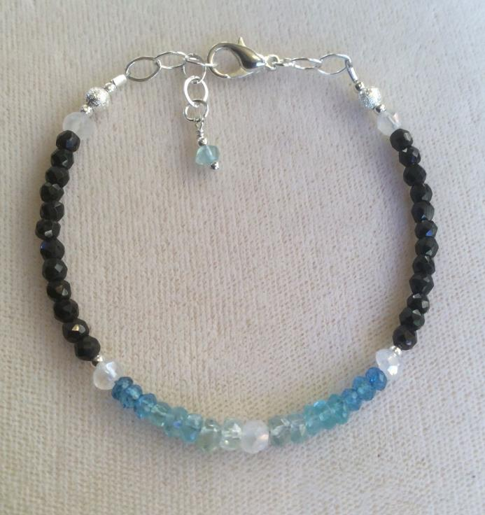Blue topaz, Zircon, apatites, rainbow moonstone & black tourmaline bracelet