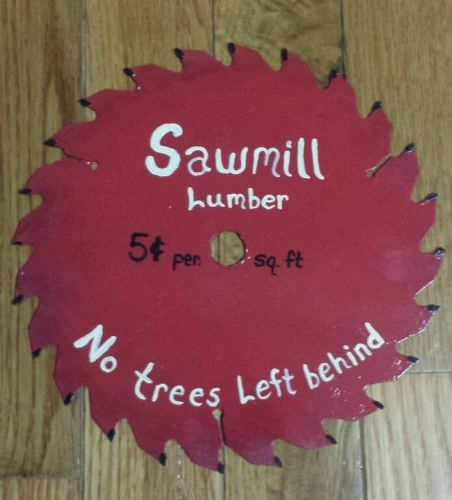 HAND PAINTED SAW BLADE RED (SAWMILL LUMBER NO TREES LEFT BEHIND) 7 1/4 DIA.
