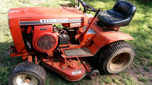 wheel horse, charger 10, riding mower, tractor, vintage, and running well.