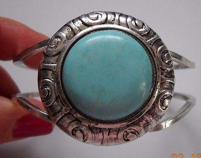 New silvertone cuff bracelet with light blue stone