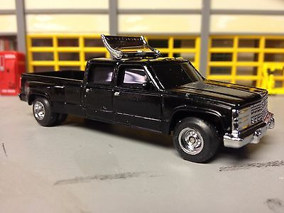1/64 97Chevy Crew Cab Dully in Black with Rubber tires on Alloy Wheels with Wing